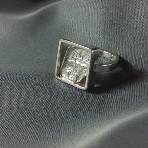 Ring: sterling silver, reticulated.